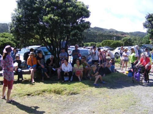 At Bethells Beach, West Auckland, participants gather prior to #HeadsInSandNZ