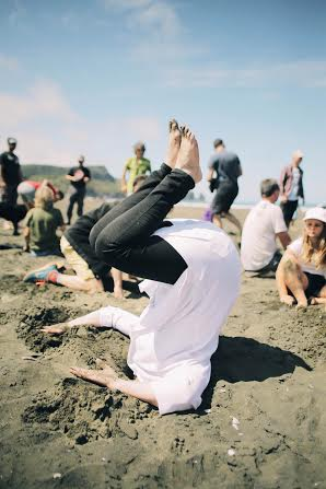 Again at Bethells Beach, Green MP Jan Logie shows her commitment to #HeadsInSandNZ in acrobatic style. Photo credit: A. Rogers / NZ Greens