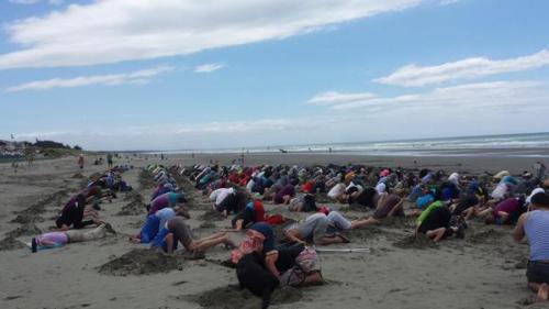 220 Christchurch people came to New Brighton Beach for #HeadsInSandNZ. Photo credit: Ruth Dyson