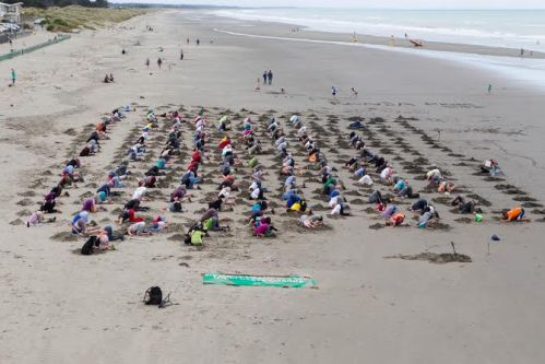 220 people took part in Heads in the Sand at Christchurch's New Brighton beach. This photo gives you a sense of the scale of the event. Photo credit: Alan Bishop