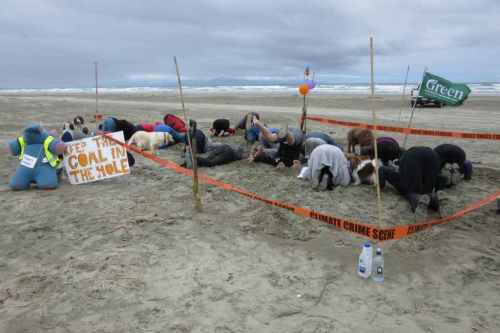 In the far south of New Zealand, on Oreti Beach, #HeadsInSandNZ was also a climate crime scene. Photo: Jenny Campbell