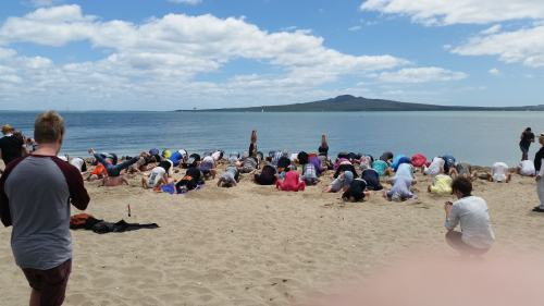 Mission Bay, Auckland: looking across a lot of Heads in the Sand to Rangitoto at one of 4 Auckland events today