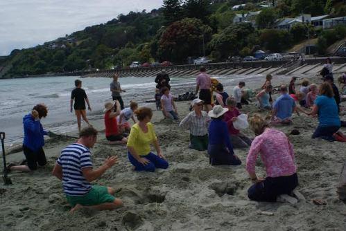 People getting ready to put their #HeadsInSandNZ at Nelson's Tahunanui Beach. Photo: Sara Cooper