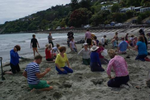 People getting ready to put their #HeadsInSandNZ at Nelson's Tahunanui Beach. Photo: Sara Cooper