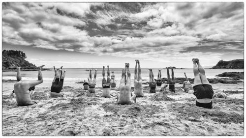 Heads in the sand, saluting the sun:  Waiheke Island takes part in #HeadsInSandNZ. Photo: Peter Rees